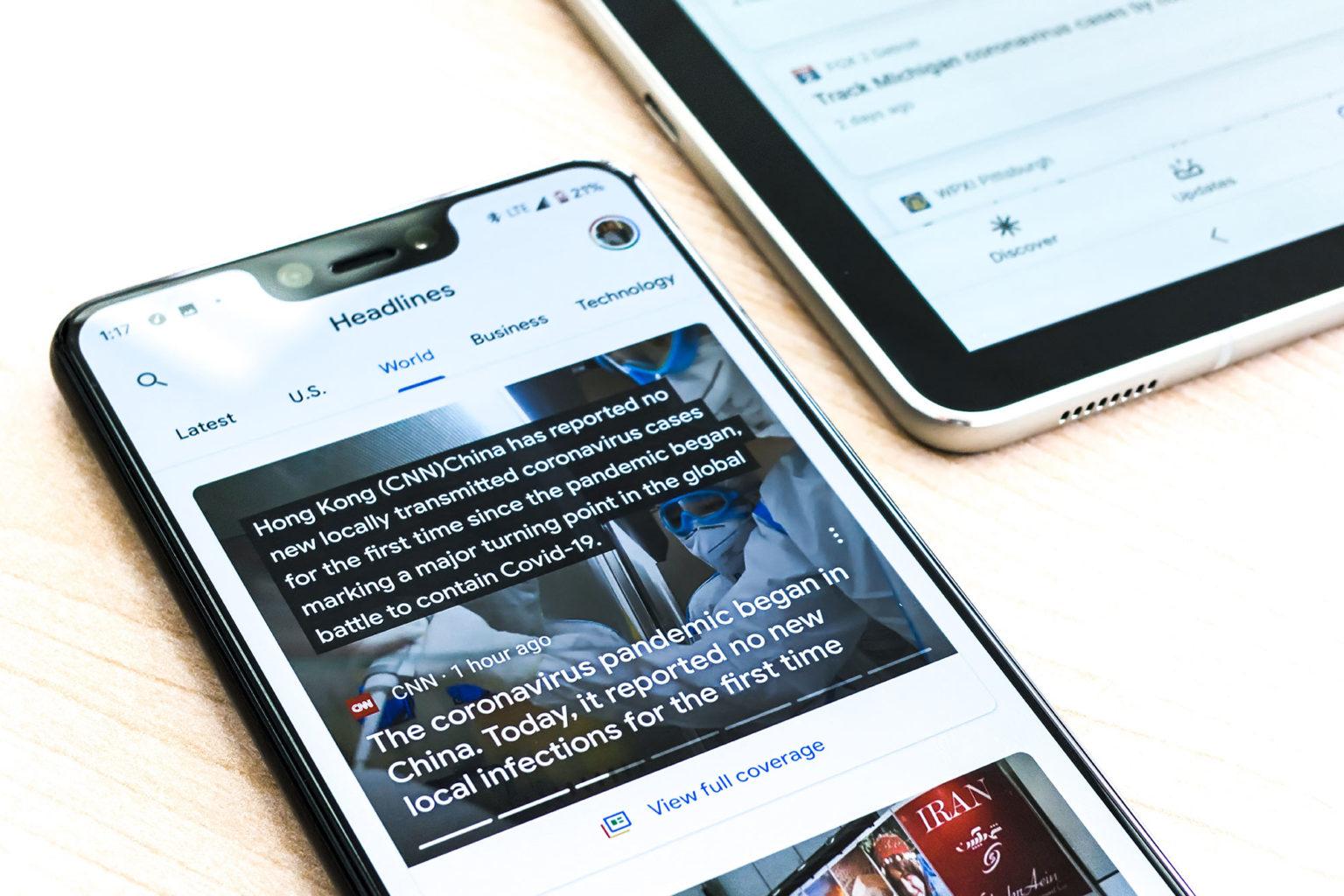 A smartphone displays a news website